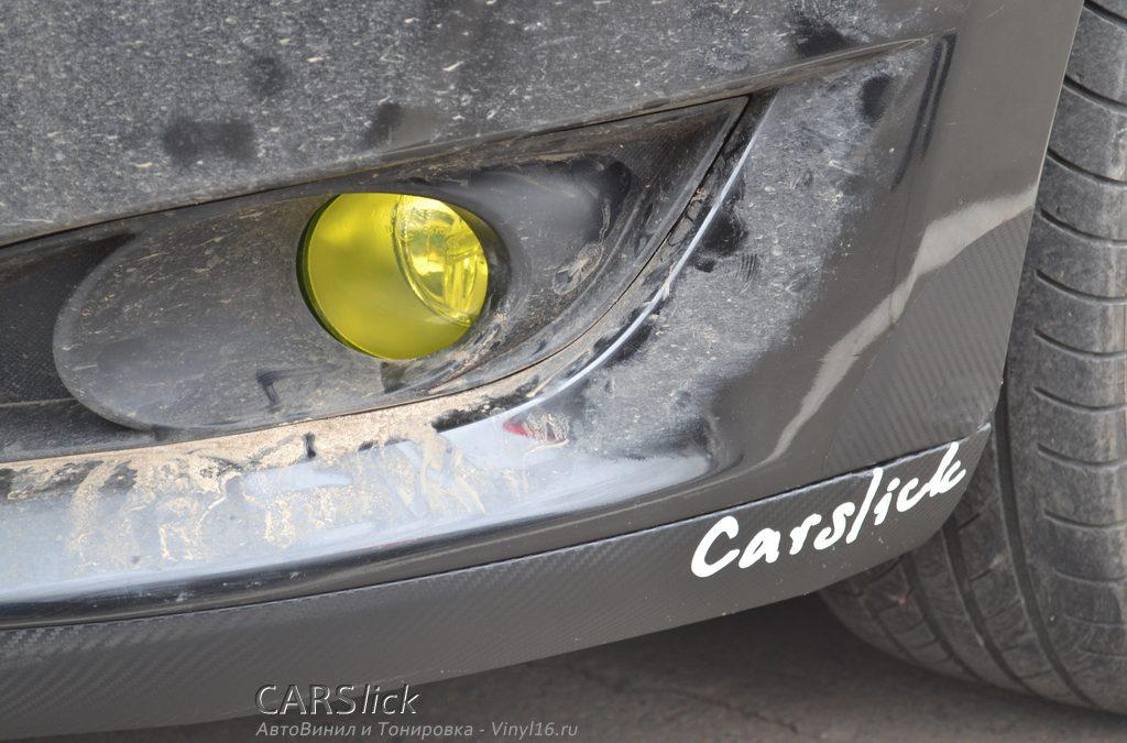 Юбка переднего бампера карбоновой пленкой — Corolla