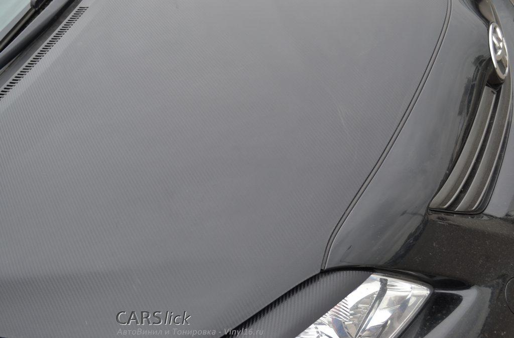 Оклейка карбоном капота и реснички на Toyota Corolla