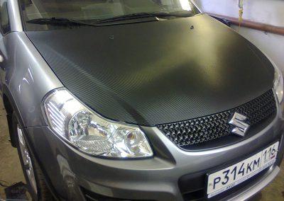 Перетяжка капота и зеркал 3 d carbon и бронирование фар Suzuki