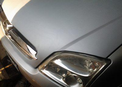 Оклейка серебристым карбоном Opel