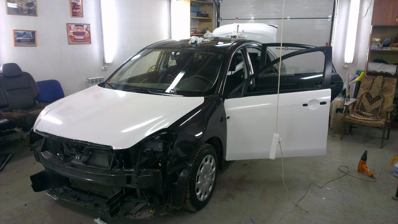 Nissan Almera — оклейка авто в Казани для такси — ноябрь 2013