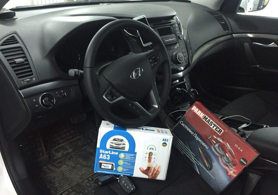 Установка сигнализации с автозапуском Starline А93 и задних парктроников на Hyundai I40