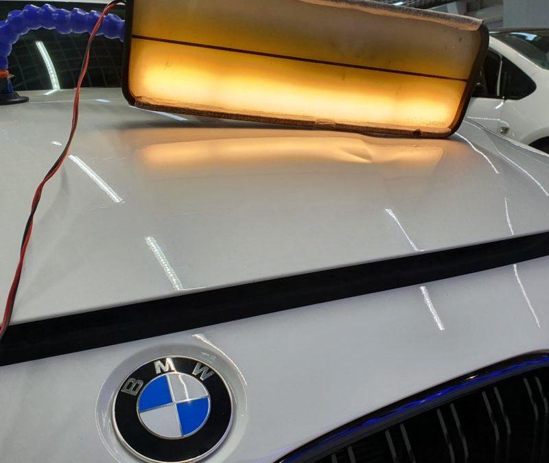 Ремонт вмятины на капоте автомобиля BMW